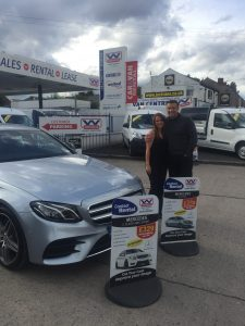 Laura Edwards, Director of Finance Operations, presents Matt Jackson with the keys to his Mercedes E-Class