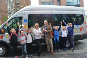 Stephanie Cheetham presenting the new minibus from Westwood to Wigan Youth Zone