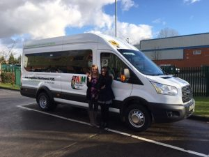 aim together collecting a bus wigan hire